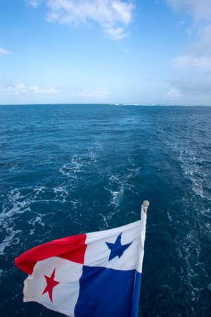 panama flag: The Panama Flag waving with the horizon and the sea in the San Blas Islands, Panama 2014.