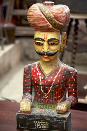 flee: Wooden old vintage statue of musician from Rajasthan in flee market Stock Photo
