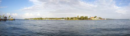 bocas del toro: Colorful Caribbean buildings over the water with boats at dock, Colon island, Bocas Del Toro, Panama 2014. Stock Photo