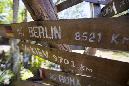 multi national: Multi destination Wooden sign arrows in Canaima National Parkk, Venezuela 2015