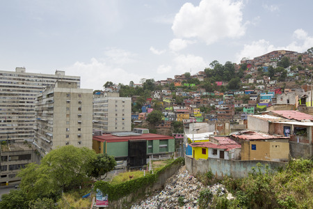 caracas: Small wooden colored houses in the poor neighborhood in Caracas. It cover the hills around Caracas and it is dangerous at all times.