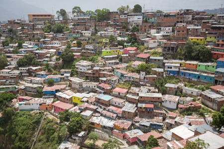 caracas: Small wooden coloured houses in the poor neighborhood in Caracas. It cover the hills around Caracas and it is dangerous at all times.
