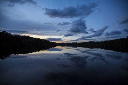 gauja: Sunset in the Canaima National Park and reflections in the water of the Gauja river. Bolivar State, Venezuela 2015 Stock Photo