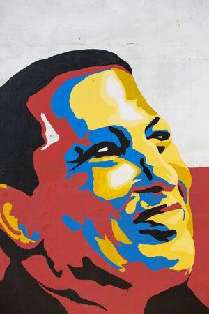 hugo: MARGARITA, VENEZUELA, APRIL 15: Colourful graffiti of head of President Hugo Chavez in the wall of Pampatar. Venezuela Editorial
