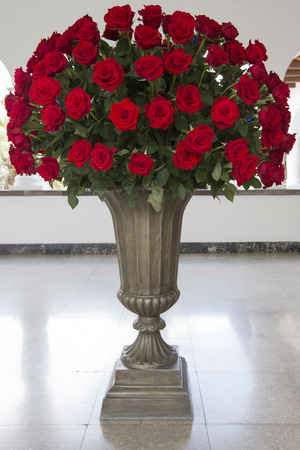 huge: Huge bunch of red roses in stone vase located in the Presidential Palace, Quito. Ecuador.