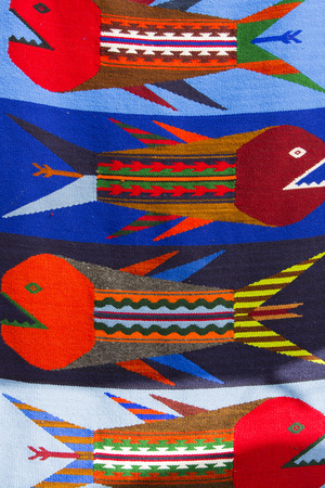 artisanry: Background of colored Ecuadorian textile at the market of Otavalo in Ecuador, 2015.