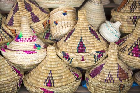 moroccan cuisine: Traditional wicker tajines stacked in a shop in Marrakesh Souq or medina Stock Photo