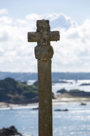 st  michel: Cross of St Michel Church on the island of Brehat in Brittany with the ocean and the land in the background