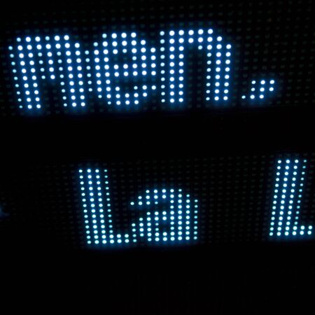 led display: Word Men displayed on led display with black background