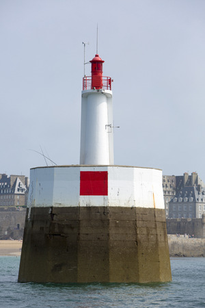 st  malo: Lighthouse of St Malo with fisher men in action againts blue sky, Brittany, France