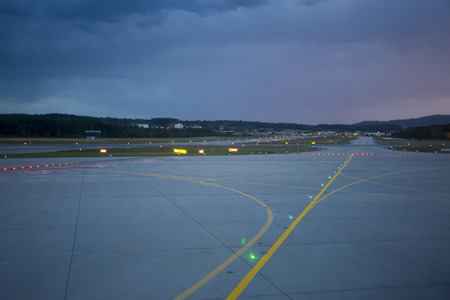 Landing lights at night on the main runway at the airport of Trieste in Italy Stock Photo