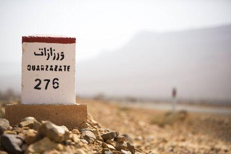 kilometres: Ouarzazate 276 kilometres - road sign distance indicator on the road to Ouarzazate with blurred background, Morocco