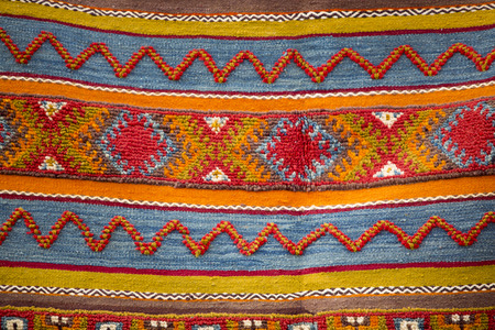 red carpet background: Colourful african moroccan style rug surface close up. Berber style from the Northern Morocco.