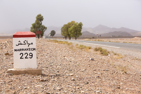 marrakesh: Marrakesh 229 kilometers - roadside distance indicator on the road to Marrakesh, Morocco
