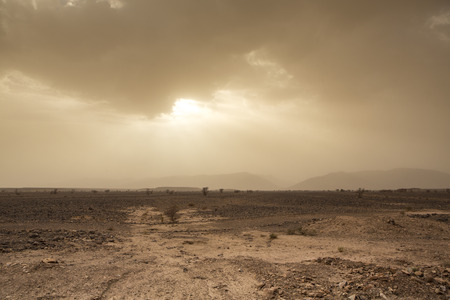 Wind and skittish sky in the desert of Sahara in Morocco