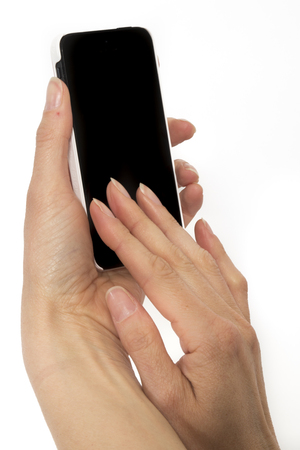 holding smart phone: Isolated female hands holding smart phone