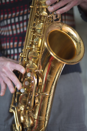 soprano saxophone: Close-up on hands playing saxophone during a jazz concert in Brussels.