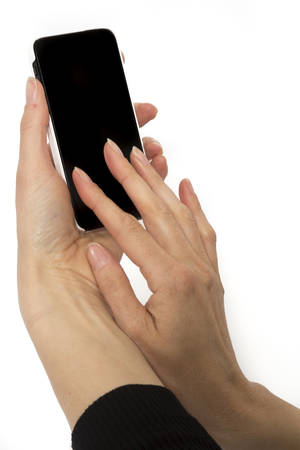 input device: Isolated female hands holding smart phone Stock Photo