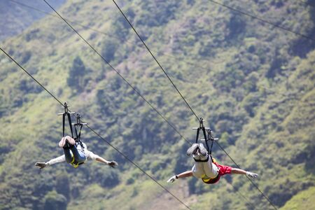 BANOS, ECUADOR, FEBRUARY 21: Unidentified people falling on a zip line adventure park in Ecuadorian rainforest, Banos de Agua Santa, the adventure capital of Ecuador 2015.