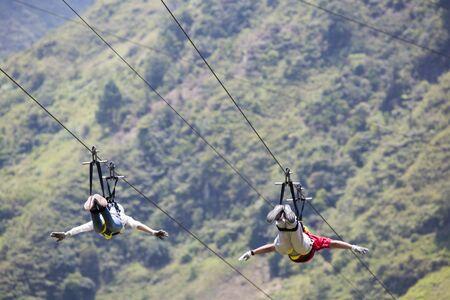 adrenaline rush: BANOS, ECUADOR, FEBRUARY 21: Unidentified people falling on a zip line adventure park in Ecuadorian rainforest, Banos de Agua Santa, the adventure capital of Ecuador 2015.