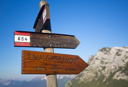 dolomite: Foro Camp signs with blue sky and blurred mountains in the background, Dolomite, Italy Stock Photo