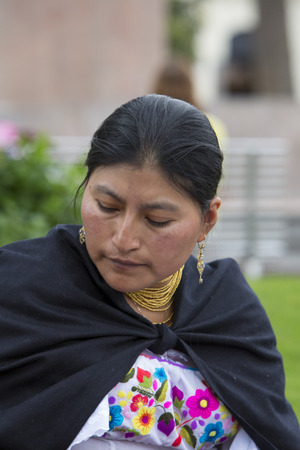 aboriginal woman: OTAVALO, ECUADOR - FEB 28, 2015: Unidentified Ecuadorian woman at the Otavalo Market. Most of the Ecuadorian people belong to the Mestizo ethnic group, famous for their art and music. Ecuador 2015.