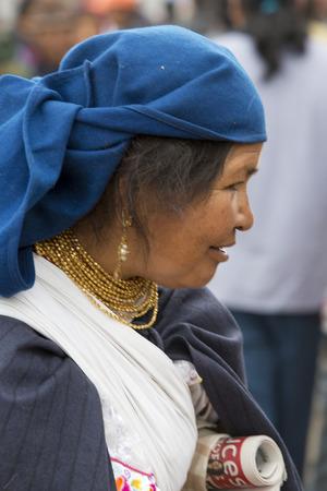 ecuadorian: OTAVALO, ECUADOR - FEB 28, 2015: Unidentified Ecuadorian old woman at the Otavalo Market. Most of the Ecuadorian people belong to the Mestizo ethnic group, famous for their art and music. Ecuador 2015.