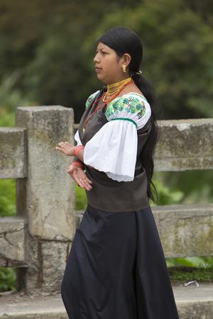 ecuadorian: OTAVALO, ECUADOR - FEB 28, 2015: Unidentified Ecuadorian woman at the Otavalo Market. Most of the Ecuadorian people belong to the Mestizo ethnic group, famous for their art and music. Ecuador 2015.