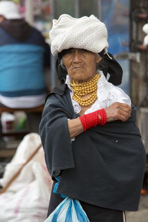 indian artifacts: OTAVALO, ECUADOR - FEB 28, 2015: Unidentified Ecuadorian old woman at the Otavalo Market. Most of the Ecuadorian people belong to the Mestizo ethnic group, famous for their art and music. Ecuador 2015.