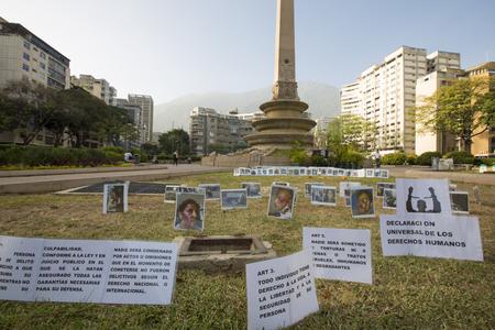 regime: CARACAS, VENEZUELA, APRIL 20: Photos and messages protesting against the political regime in Venezuela laying on the grass plaza de Francia, Caracas. Venezuela 2015 Editorial
