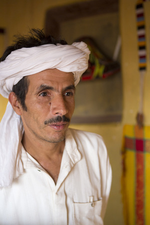 bedouin: Ait-Ben-Haddou, Morocco - August 31, 2014: Portrait of handsome traditional Bedouin wearing with a white robe and a white turban Editorial