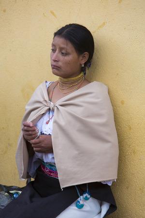 indian artifacts: OTAVALO, ECUADOR - FEB 28, 2015: Unidentified Ecuadorian woman at the Otavalo Market. Most of the Ecuadorian people belong to the Mestizo ethnic group, famous for their art and music. Ecuador 2015.