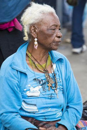 aboriginal woman: OTAVALO, ECUADOR - FEB 28, 2015: Unidentified Ecuadorian old woman at the Otavalo Market. Most of the Ecuadorian people belong to the Mestizo ethnic group, famous for their art and music. Ecuador 2015.