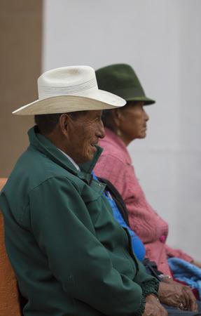 latina america: BANOS, ECUADOR, FEBRUARY 21: Unidentified old indigenous locals sitting in the street of Banos de Agua Santa, Ecuador 2015.