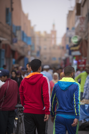 sabre's: Tiznit, Morocco - August 26, 2014: Unidentified people walking and shopping in the old street of Tiznit in Morocco. 2014. Tiznit is a town in the southern Moroccan, founded in 1881. Tiznit is well known for its silver jewellery, daggers and sabres. Editorial