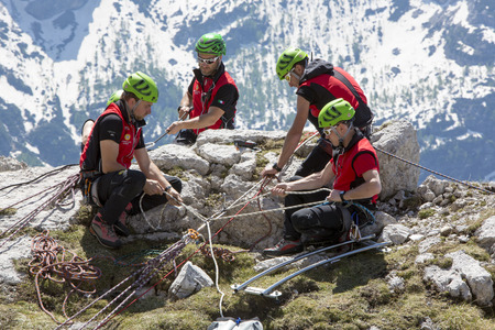 CORTINA DAMPEZZO, ITALY, June 08: Mountain rescue team members in action in the mountains of Dolomites also known as the Soccorso Alpino - June 8th 2014 in Italy.