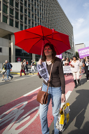 slaughter: BRUSSELS, BELGIUM, SEPTEMBER 28: Belgian Gaia activists protest on the streets of Brussels on September 28, 2014 against slaughter without stunning. Support of people to petition for stunning animals before slaughter so they are unconscious before being k Editorial