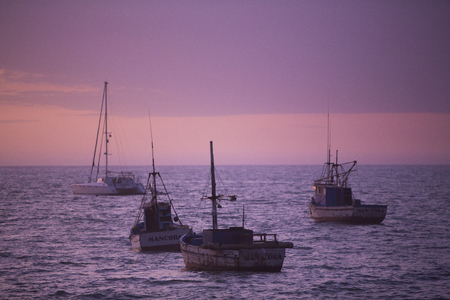 manora: MANCORA, PERU, JANUARY 31: Purple sunset on the harbor of Manora. Peru 2015 Stock Photo