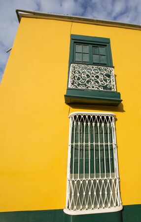 Yellow and green colonial architecture in the historic center of Trujillo, Peru Stock Photo