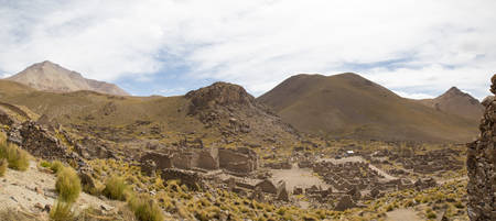 lipez: Panorama of abandoned and decaying houses in San Antonio ghost village at the footstep of San Antonio volcano in the Bolivian altiplano.