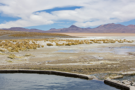 lipez: Hot springs in the middle of Sur Lipez desert at the Termas de Polques. View on the mountains. Bolivia