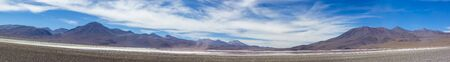 lipez: Panorama of mountains and white salt pan in Eduardo Avaroa Andean Fauna National Reserve against a clear blue sky, Bolivia