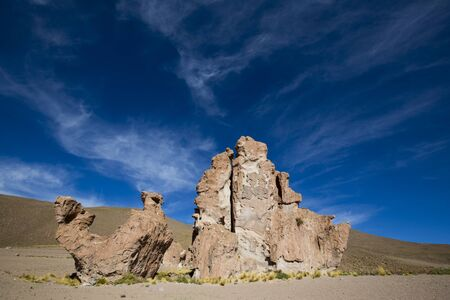 rock formation: Geological rock formation with the shape of a camel against a clear blue sky. Bolivia
