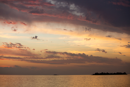 tapering: Fantastic colored sunset on the river Rio de la Plata. A tapering intrusion of the Atlantic Ocean on the east coast of South America between Uruguay to the north and Argentina to the south.