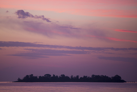 intrusion: Fantastic colored sunset on the river Rio de la Plata. A tapering intrusion of the Atlantic Ocean on the east coast of South America between Uruguay to the north and Argentina to the south.