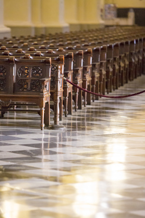 plaza de armas: Wooden seats inside the cathedral on the Plaza de Armas in Lima. Peru 2015