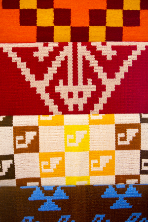 indigenous: Colored fabrics with pattern of indigenous sign in Peruvian art and craft indigenous market. Trujillo, Peru