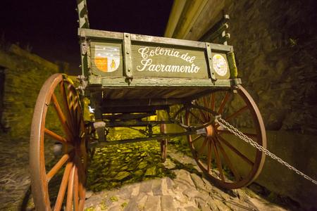 colonia del sacramento: Uruguay - Colonia Del Sacramento - Decorative Wooden Wagon In The Street Of The Old Town  Vintage - Wooden Wagon at night. Stock Photo