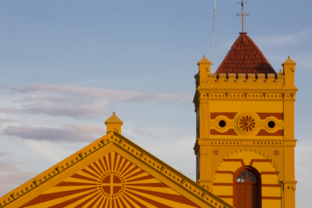 colonial church: Sunset and orange colonial church in the city of Boa Vista, blue sky in the background. North of Brazil