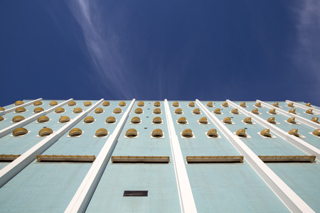 contempory: BUENOS AIRES, ARGENTINA, NOVEMBER 16: Details of plastic windows on contemporary office building facade in Buenos Aires with a blue sky. Argentina 2015 (Low angle view) Editorial